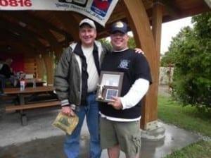 SPC David Amore, hometown – Newark, OH, with Region 8 boat captain Tom Cirilli joyfully receives the Big Fish Award